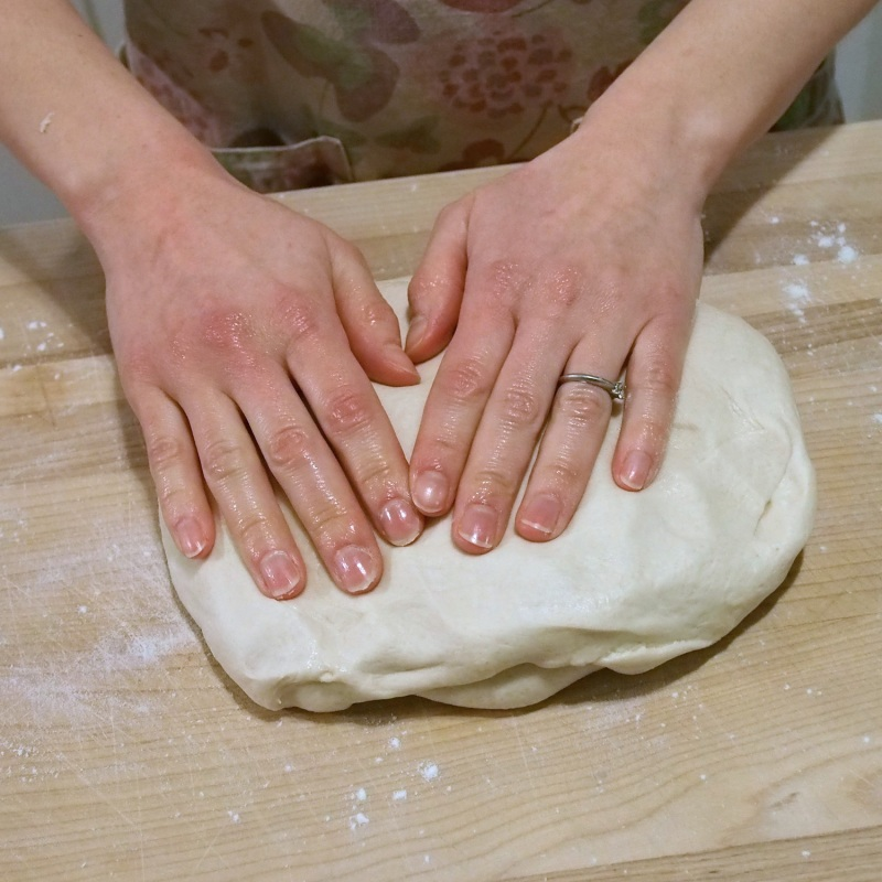 Gently press dough into an 8 inch square.